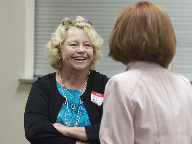 Vicki Stewart-Benizio, great-great-great-granddaughter of Helen J. Stewart, left, talks with an attendee during a League of Women Voters meeting at University United Methodist Church in Las Vegas, ...
