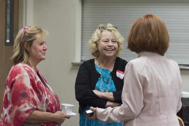 Vicki Stewart-Benizio, great-great-great-granddaughter of Helen J. Stewart, center, mingles with League of Women Voters meeting attendees at University United Methodist Church in Las Vegas, Saturd ...