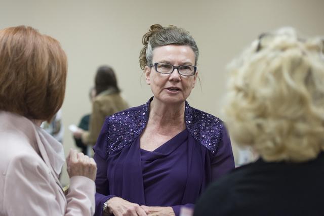 Linda Miller, dressed as Helen J. Stewart, center, mingles with League of Women Voters meeting attendees at University United Methodist Church in Las Vegas, Saturday, Nov. 19, 2016. Jason Ogulnik/ ...