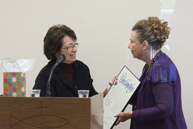 Linda Miller, dressed as Helen J. Stewart, right, receives a proclamation from Clark County Commissioner Mary Beth Scow during a League of Women Voters meeting at University United Methodist Churc ...