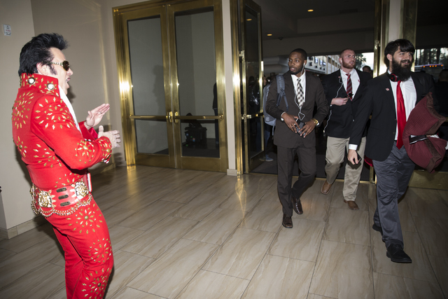 University of Houston football coach Kenny Guiton, from left, and players Zach Vaughan, and Zach Faires, arrive at the Delano Las Vegas hotel on Tuesday, Dec. 13, 2016, in Las Vegas. (Erik Verduzc ...