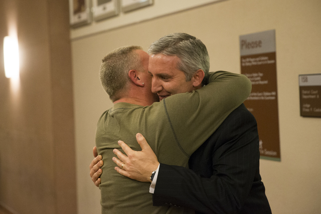 William Postorino, left, embraces Chief Deputy District Attorney Giancarlo Pesci, after Norman Belcher, a 41-year-old man accused of killing his 15-year-old girl, was found guilty of first degree  ...