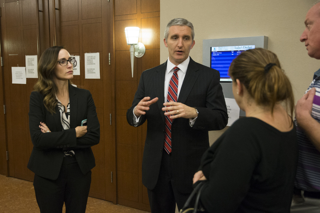 Chief Deputy District Attorneys Jacqueline Bluth, left, and Giancarlo Pesci, speak to the family of a 15-year-old girl murder victim after Norman Belcher, a 41-year-old man, was found guilty of fi ...