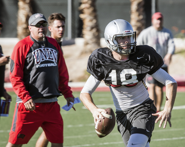 UNLV coach Tony Sanchez, left, watches starting quarterback Dalton Sneed passes the football during practice on Tuesday, Oct. 4, 2016. (Jeff Scheid/Las Vegas Review-Journal) Follow @jeffscheid