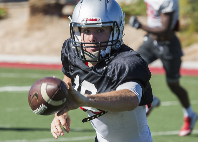 UNLV starting quarterback Dalton Sneed  shovel passes the football during practice on Tuesday, Oct. 4, 2016. (Jeff Scheid/Las Vegas Review-Journal) Follow @jeffscheid