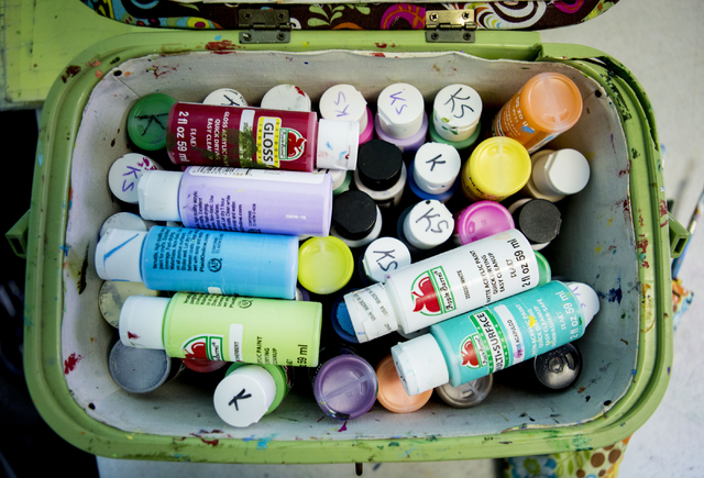 Paints belonging to Kai Schaffer, an individual at Transition Services facility with Cerebral Palsy, are labeled with her initials at the facility in Henderson, Thursday, Dec. 15, 2016. Schaffer p ...