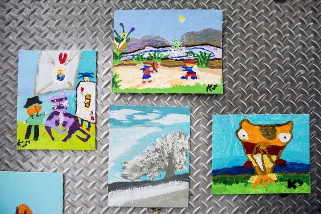 Paintings created by Kai Schaffer, an individual at Transition Services facility with cerebral palsy, are displayed at the facility in Henderson, Thursday, Dec. 15, 2016. Schaffer paints daily and ...
