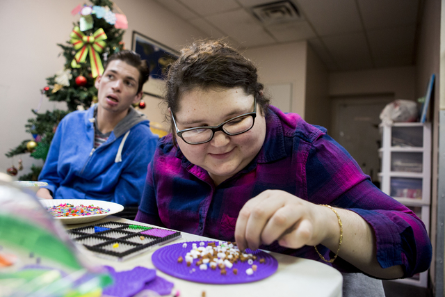 Britny Pipes, an individual at Transition Services facility, makes a tissue box to give away as a Christmas gift at the facility in Henderson, Thursday, Dec. 15, 2016. (Elizabeth Page Brumley/Las  ...