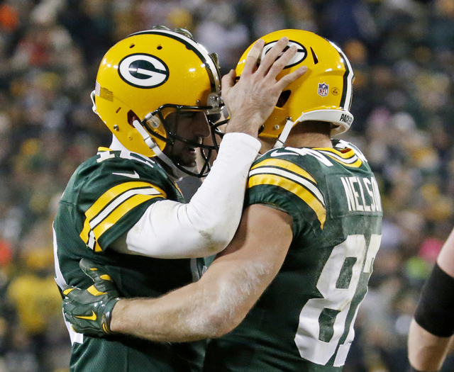In this Dec. 11, 2016, file photo, Green Bay Packers' Aaron Rodgers congratulates Jordy Nelson after a touchdown catch during the second half of an NFL football game against the Seattle Seahawks,  ...