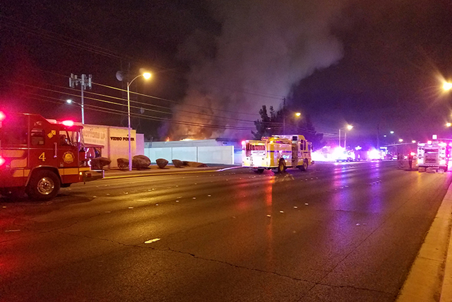Clark County and Las Vegas firefighters battle a blaze in a vacant building at 3350 E. Desert Inn Road early Wednesday morning, Dec. 14, 2016. (Mike Shoro/Las Vegas Review-Journal)