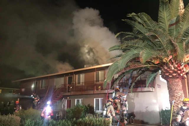 Las Vegas firefighters respond to an apartment fire at 2312 Clifford Ave., on Sunday. The cause of the fire is being investigated as 21 people have been displaced. (Courtesy)