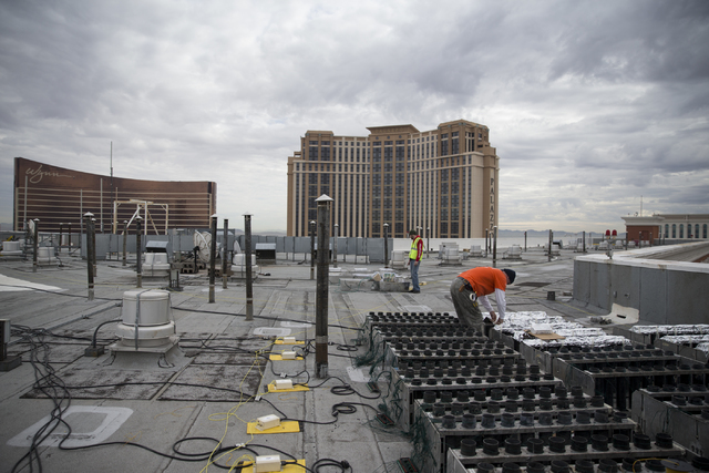 Pyrotechnicians work on the electrical wiring of fireworks for the New Year's Eve firework show on the roof of the Treasure Island hotel-casino on Friday, Dec. 30, 2016, in Las Vegas. Erik  ...