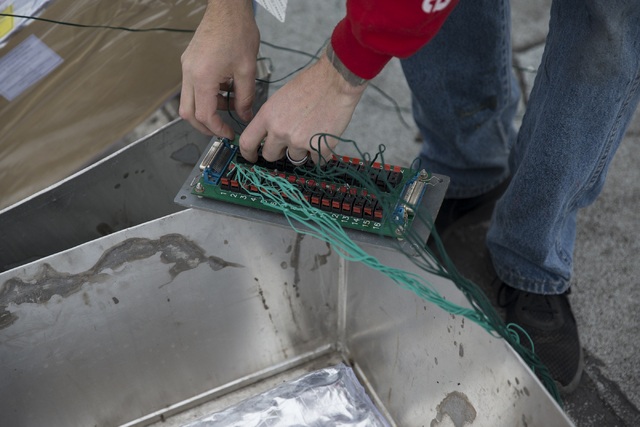 Pyrotechnician Kale Hamel works on the electrical wiring of fireworks for the New Year's Eve firework show on the roof of the Treasure Island hotel-casino on Friday, Dec. 30, 2016, in Las V ...