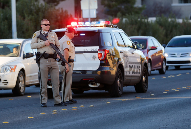 Police officers stand on a street near West Flamingo Animal Hospital in Las Vegas, Monday, Dec. 19, 2016, after an officer-involved shooting. (Chitose Suzuki/LasVegas Review-Journal)@chitosephoto