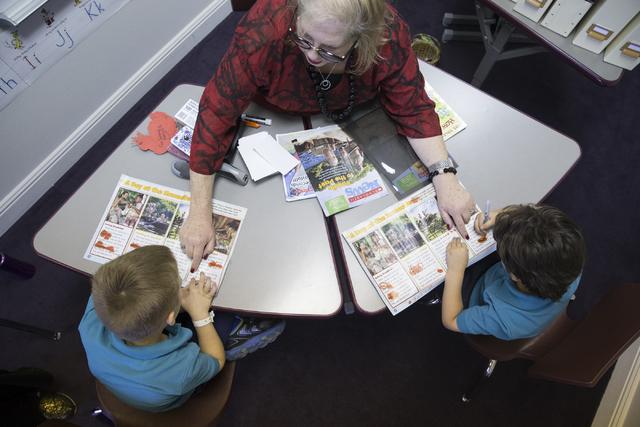 Lead teacher Allison Berman, center, instructs her kindergartners Xander Gallant, left, and Nilan Nasri, in their classroom at Nasri Academy on Wednesday, Nov. 16, 2016, in Henderson. Erik Verduzc ...
