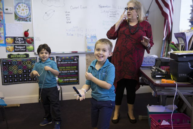 Lead teacher Allison Berman, center, with her kindergartners Nilan Nasri, left, and Xander Gallant in their classroom at Nasri Academy on Wednesday, Nov. 16, 2016, in Henderson. Erik Verduzco/Las  ...