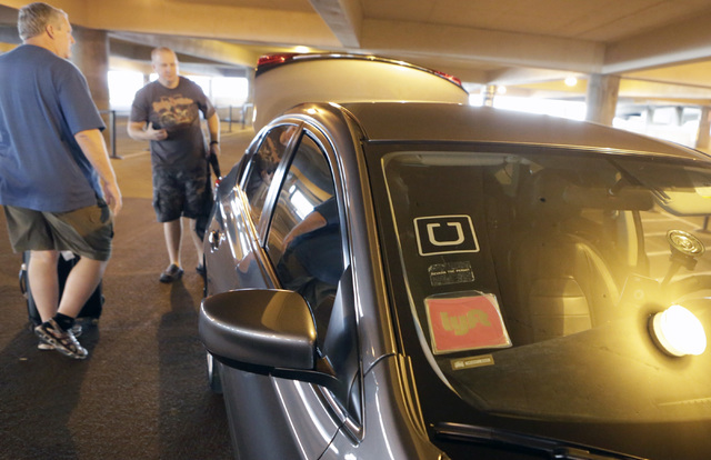 Riders prepare to load their luggage into Ride-hailing company's Uber and Lyft car at McCarran International Airport at Terminal 1 onThursday, Oct. 20, 2016. (Bizuayehu Tesfaye/Las Vegas Review-Jo ...