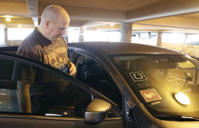 Ride-hailing company Uber driver, who refused to give his name, picks a rider up from McCarran International Airport at Terminal 1 on Thursday, Oct. 20, 2016. (Bizuayehu Tesfaye/Las Vegas Review-J ...