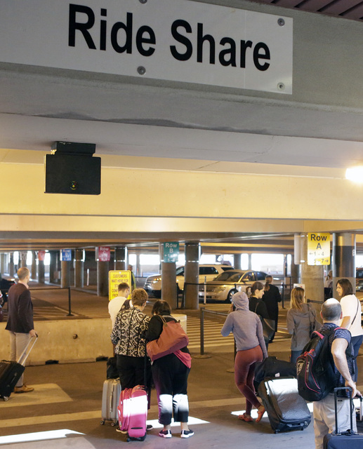 Riders wait for their ride at Ride Share pick up area at McCarran International Airport at Terminal 1 on Thursday, Oct. 20, 2016. (Bizuayehu Tesfaye/Las Vegas Review-Journal) @bizutesfaye