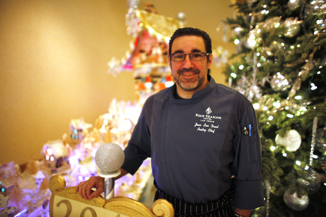 Executive Pastry Chef Jean-Luc Daul in front of the gingerbread village at the Four Seasons Hotel lobby on Monday, Dec. 12, 2016, in Las Vegas. (Rachel Aston/Las Vegas Review-Journal) @rookie__rae