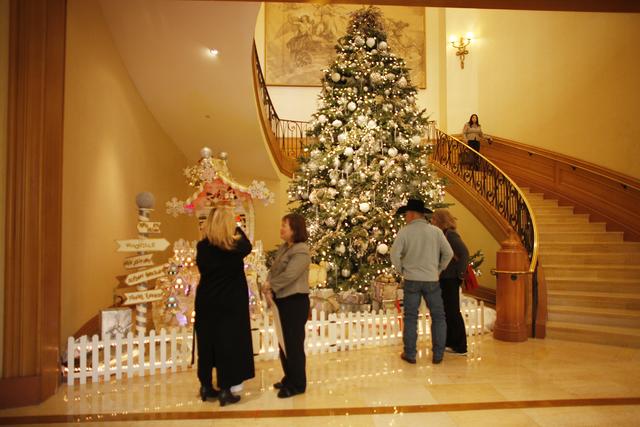 Visitors admire the gingerbread village at the Four Seasons Hotel lobby on Monday, Dec. 12, 2016, in Las Vegas. (Rachel Aston/Las Vegas Review-Journal) @rookie__rae
