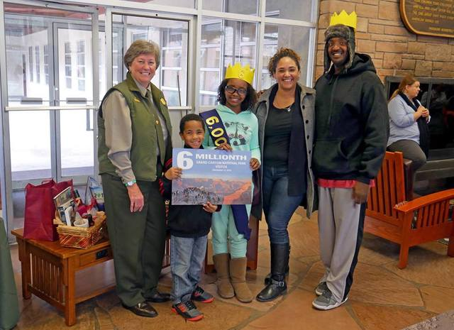 Grand Canyon National Park superintendent Chris Lehnertz, left, poses with James and Abigail Johnson and their children, Sophia and Elijah at park headquarters Monday. The Johnson family from Las  ...