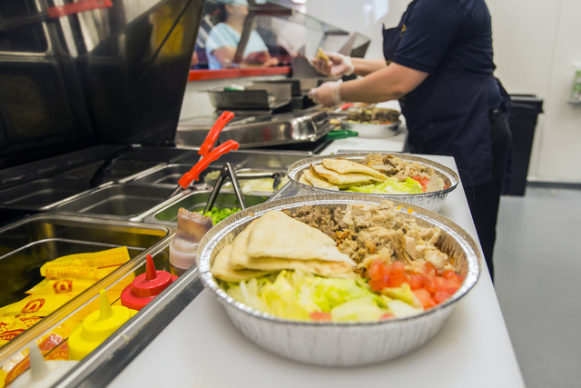 General Manager Angela Guriel Plates Food At Halal Guys 3755 Spring Mountain Road On