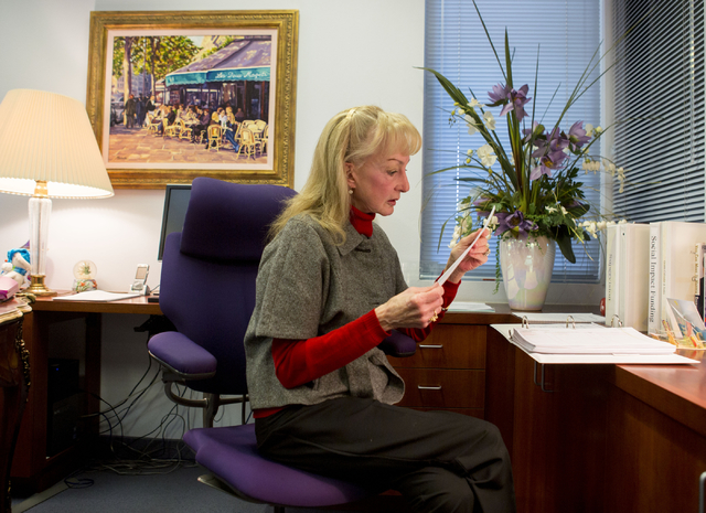 CEO and Founder of Foundation for an Independent Tomorrow, Janet Frasier Bluman, checks the classes scheduled for the day in her office at FIT, 1931 Stella Lake St., Tuesday, Dec. 6, 2016, Las Veg ...