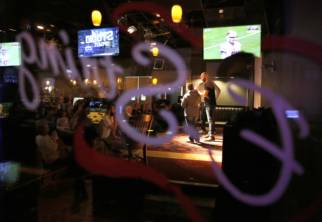 Audience members take the stage at ASL SLAM at E-String Grill and Poker Bar in Henderson on Dec. 3, 2016. ASL SLAM is a space for Deaf performing artists to share poetry and storytelling in Americ ...