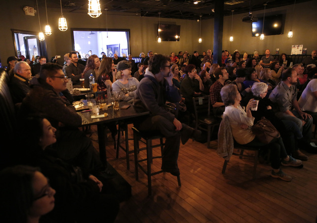 The audience at ASL SLAM at E-String Grill and Poker Bar in Henderson on Dec. 3, 2016. ASL SLAM is a space for Deaf performing artists to share poetry and storytelling in American Sign Language. ( ...