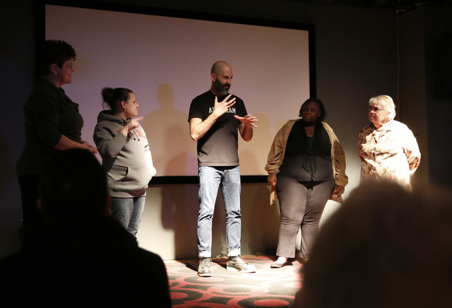 Douglas Ridloff, center, performs on stage with audience members during ASL SLAM at E-String Grill and Poker Bar in Henderson on Dec. 3, 2016. ASL SLAM is a space for Deaf performing artists to sh ...