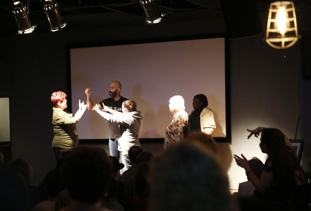 Douglas Ridloff performs on stage with audience members during ASL SLAM at E-String Grill and Poker Bar in Henderson on Dec. 3, 2016. ASL SLAM is a space for Deaf performing artists to share poetr ...