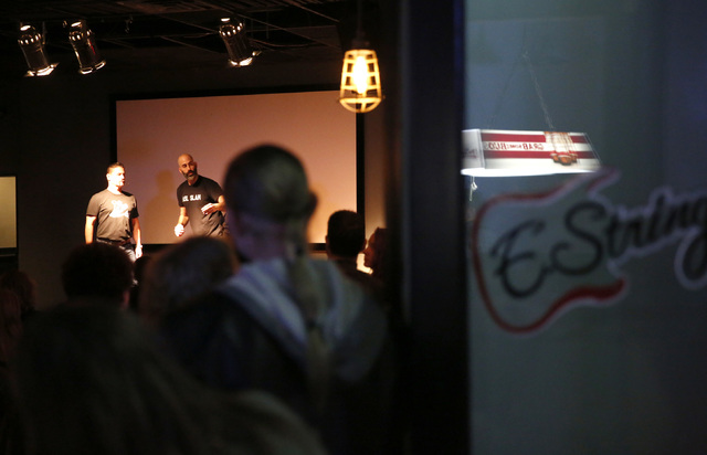 Jon Savage, left, and Douglas Ridloff take the stage during ASL SLAM at E-String Grill and Poker Bar in Henderson on Dec. 3, 2016. ASL SLAM is a space for Deaf performing artists to share poetry a ...