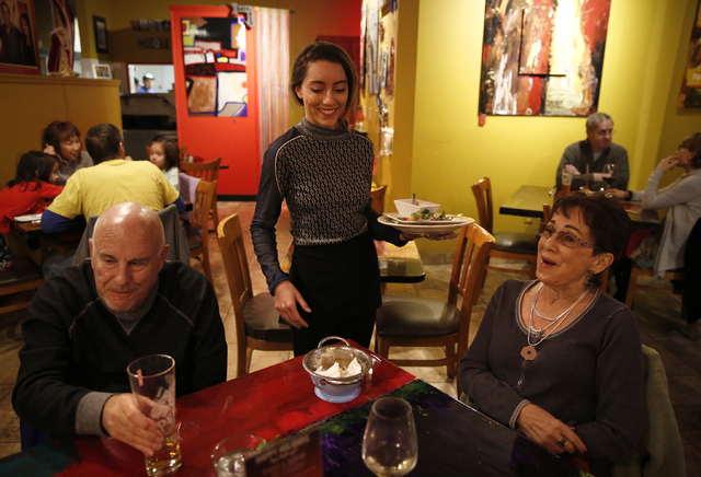 Bianca Alenik, center, tends to longtime patrons Harvey and Patti Miller at Pasta Shop Ristorante and Art Gallery on Friday, Dec. 16, 2016 in Henderson. The restaurant is now owned and operated by ...
