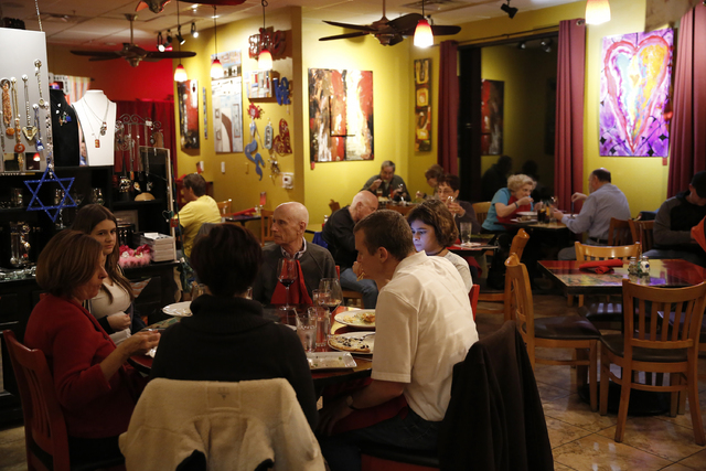 Patrons at Pasta Shop Ristorante and Art Gallery on Friday, Dec. 16, 2016 in Henderson. The restaurant is now owned and operated by the wife and children of David Alenik, who died unexpectedly in  ...