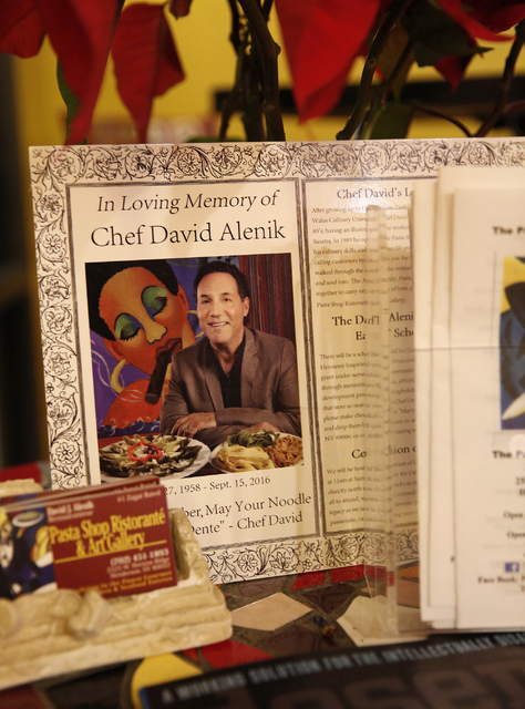 A memorial for David Alenik is displayed at the Pasta Shop Ristorante and Art Gallery entrance on Friday, Dec. 16, 2016 in Henderson. The restaurant is now owned and operated by the wife and child ...