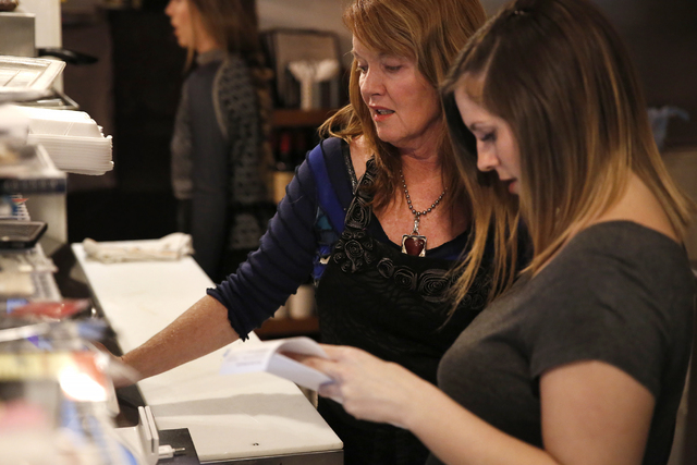 Owner Ann Alenik, left,  speaks with employee Gianna Cormaci at Pasta Shop Ristorante and Art Gallery on Friday, Dec. 16, 2016 in Henderson. The restaurant is now owned and operated by the wife an ...