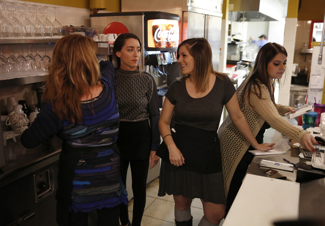 Owner Ann Alenik, left, speaks with her daughter, Bianca Alenik, Gianna Cormaci and Gabbie Mangona at Pasta Shop Ristorante and Art Gallery on Friday, Dec. 16, 2016 in Henderson. The restaurant is ...