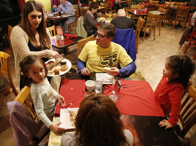 Gabbie Mangona displays a desert menu to the Taylor family at Pasta Shop Ristorante and Art Gallery on Friday, Dec. 16, 2016 in Henderson. The restaurant is now owned and operated by the wife and  ...