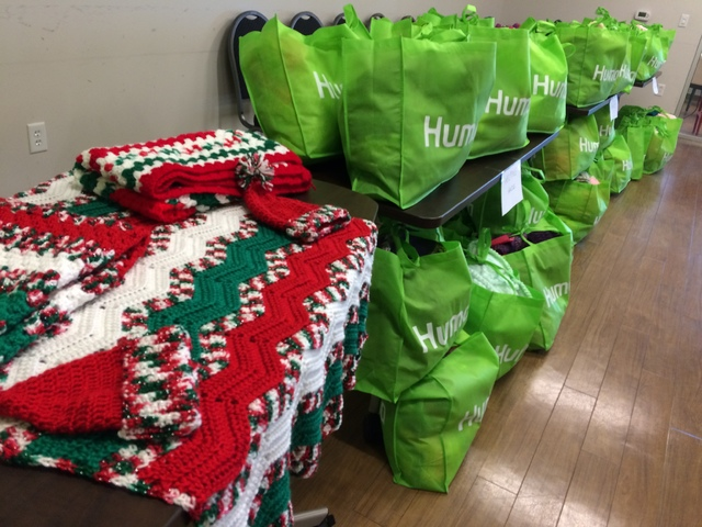 Hats, scarves and an afghan, along with bags filled with like items, are seen Nov. 22 at the Humana Guidance Center, 8885 W. Charleston Blvd., Suite 140. (JAN HOGAN/VIEW)