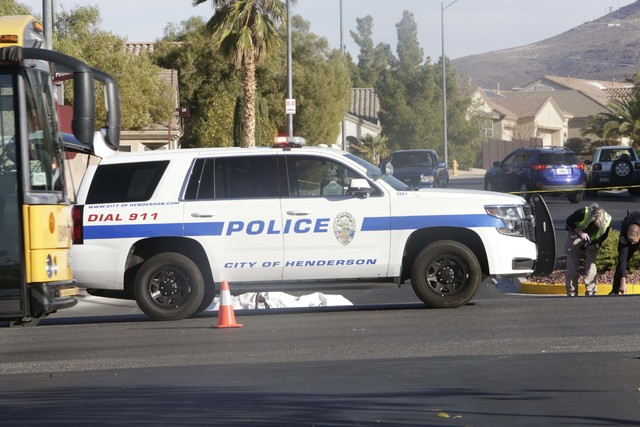 Henderson police investigate a fatal crash involving a motorcycle and car at Sun City Anthem Drive and Thunder Bay Avenue in Henderson, Tuesday, Dec. 6, 2016. (Bizuayehu Tesfaye/Las Vegas Review-J ...