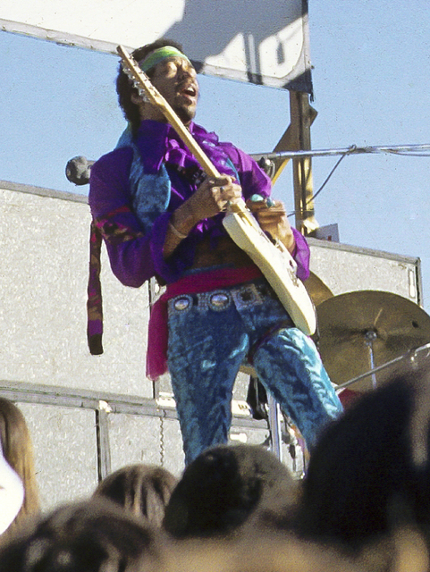 This May 1969 photo made by Stephen McCabe at the age of 15 shows musician Jimi Hendrix performing at the Santa Clara County, Calif., Folk Rock Festival. (Stephen McCabe via AP)