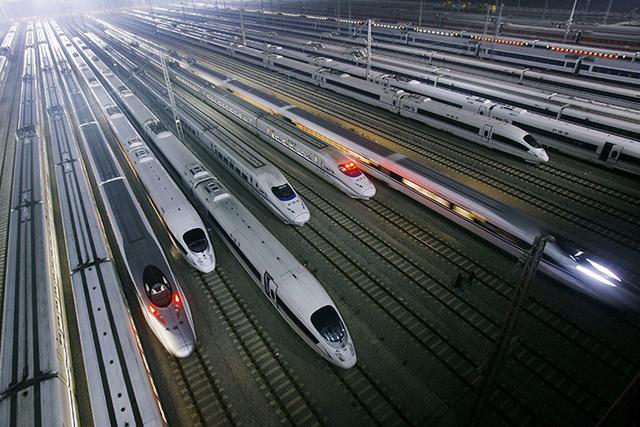In this Wednesday, Jan. 11, 2012 file photo, China's CRH high-speed trains sit on tracks at a maintenance base in Wuhan, in central China's Hubei province. The Chinese government is planning to ex ...