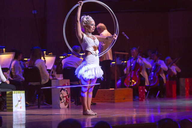 """""""Winter Wonderland"""" provides the melodic accompaniment for circus veteran Ashley Winn's hoops routine in the Cirque Musica Holiday Spectacular. (TCG Entertainment)"""