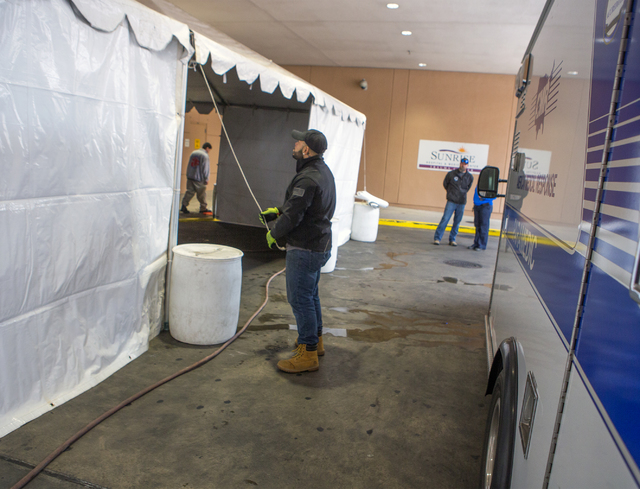 A man works on Sunrise Hospital triage tent on Friday, Dec. 30, 2016. The hospital is preparing for all types of injuries during New Year's Eve. Jeff Scheid/Las Vegas Review-Journal Follow @jeffscheid