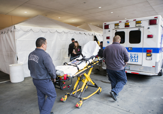 AMR paramedics push a gurney beside the temporary Sunrise Hospital triage tent on Friday, Dec. 30, 2016. The hospital is preparing for all types of injuries during New Year's Eve. Jeff Scheid/Las  ...