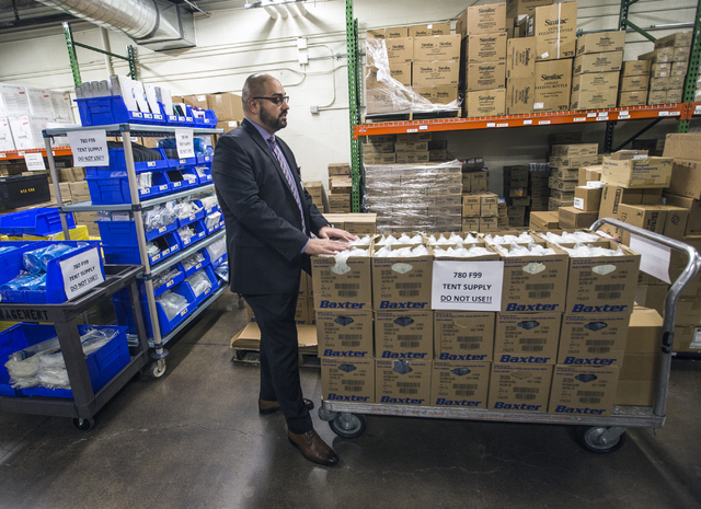 Daniel Llamas, Sunrise Health Systems' Emergency Medical Services director, looks at a supplies for the Sunrise Hospital triage tent on Friday, Dec. 30, 2016. The hospital is preparing for all typ ...