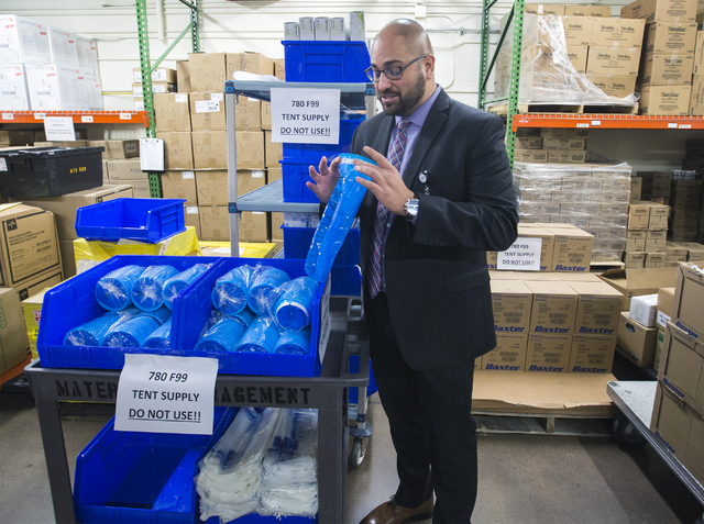 Daniel Llamas, Sunrise Health Systems' Emergency Medical Services director, looks at vomit bags for the Sunrise Hospital triage tent on Friday, Dec. 30, 2016. The hospital is preparing for all typ ...