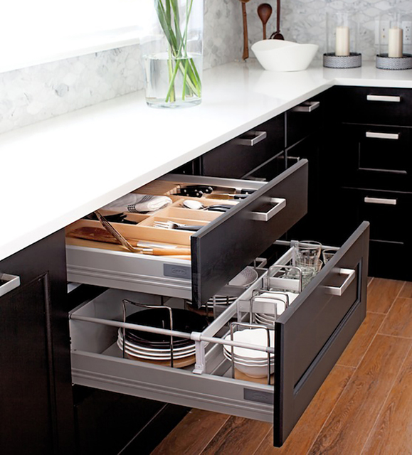 COURTESY IKEA Kitchen organizers from Ikea turn chaotic drawers and hard-to-reach corners into things of beauty and efficiency.