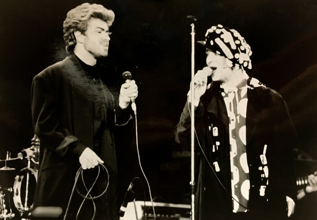 In this 1987 file photo, singer George Michael, left, performs with Boy George during Stand By Me AIDS Day Benefit Concert.
